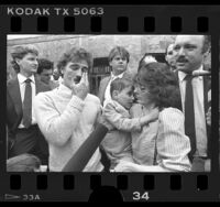 Ryan Thomas and parents outside courthouse after AIDS case verdict, Calif., 1986
