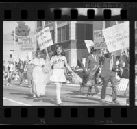 Satirical anti-feminist participants in Doo Dah Parade, Pasadena, Calif., 1986