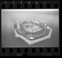 Aerial view of THUMS operated, man-made Island White in Long Beach Harbor, Calif., 1986