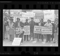 Afghani protesters with signs decrying Soviet occupation of Afghanistan, Los Angeles, 1986