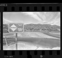 """""""Warning Wading & Swimming Unsafe"""" sign posted at Malibu Lagoon, Calif., 1978"""