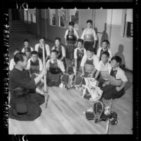 Torao Mori teaching Centinela Valley Japanese youngsters rudiments of kendo in Lawndale, Calif., 1958