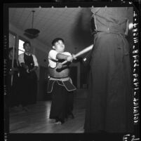 Brian Togohata puffs hard during Kendo practice session with Torao Mori in Lawndale, Calif., 1958