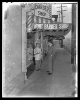 Richard Nixon on an early-morning stroll, chatting with barbershop owner in Los Angeles, Calif., 1958