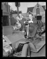 Sergei Gerasimov and Playwright Georgrii Mdivani tour Disneyland in fire engine, Anaheim, 1958