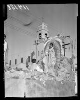 Our Lady of Guadalupe as portrayed on parade float by Maria Duran in Los Angeles, Calif., 1958