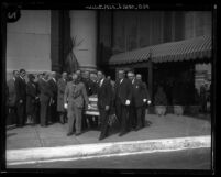 Pallbearers escorting sheriff Martin Aguirre's coffin at 1929  funeral service in Los Angeles, Calif.