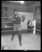 African American Vic Alexander shadow-boxing in ring, circa 1920