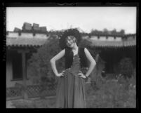 Dancer Evelyn Adams posing in a courtyard, circa 1920
