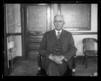 Los Angeles City Engineer, John J. Jessup sitting in chair with hands in lap, circa 1931