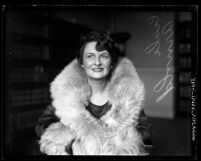 Portrait of silent film actress Cecile Arnold wearing feather boa in 1930, Los Angeles, Calif.