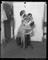 Gaby Arnold and Ernesto Sanchez posing in costume, circa 1920