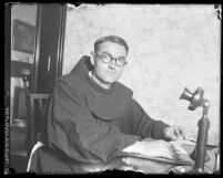 Father Superior Augustine seated at his desk at Santa Barbara Mission, Calif., 1925