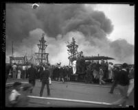 Spectators watching fire at 1929 Los Angeles Auto Show