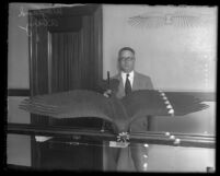 Wayland Avery with J.H. Montgomery's model airplane designed like bird's wings, Calif., 1930