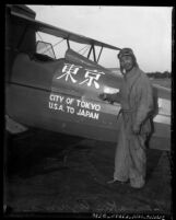 Zensaku Azuma next to the plane he flew from the United States to Tokyo, 1930