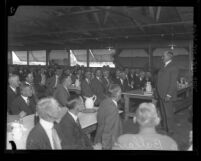 Russell H. Ballard, president of Southern California Edison Company, addressing a group of men, circa 1930