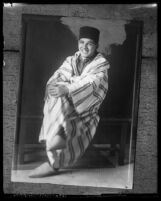 Moor Prince Mohamed Barada sitting with legs crossed, circa 1924