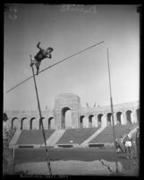 Lee Barnes in the midst of a pole vaulting attempt at the Los Angeles Memorial Coliseum, 1924