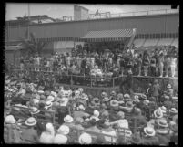 Crowd and stage full of beauty contestants at Venice Beach, Calif, circa 1925
