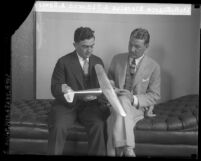 Eugene Biscailuz sitting with Richmond A. Edwards a member of Los Angeles' first sheriff airplane squadron