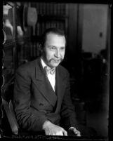 Ward Blackburn, husband of May Otis Blackburn sitting in a chair in Los Angeles, Calif., 1929