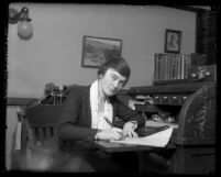 Margaret Bullen, superintendent of Los Angeles' Juvenile Hall, at her desk writing, 1921