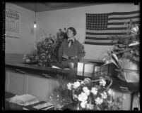 First female Los Angeles Superior Court judge Georgia P. Bullock standing at her bench surrounded by flowers