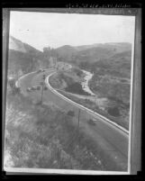 View of cars traveling on Cahuenga Pass Parkway, Los Angeles, circa 1920
