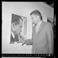 Edward C. Nixon, viewing photography exhibit on his brother President Richard Nixon in Los Angeles, Calif., 1971