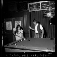 Couple playing pool at Christian nightclub, Right On in Los Angeles, Calif., 1971