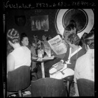 People at Christian nightclub Right On, one reading Hollywood Free Paper, in Los Angeles, Calif., 1971