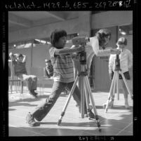 Third-graders learning to operate movie cameras at Barnsdall Park Junior Arts Center, Los Angeles, Calif., 1971