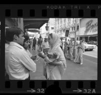 Hare Krishna members selling pamphlets in downtown Los Angeles, Calif., 1971