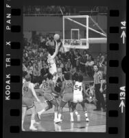 UCLA basketball player Bill Walton playing against Louisville Cardinals in NCAA semifinals, 1972