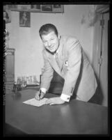 Actor Jack Carson signs up to become U.S. citizen, 1949