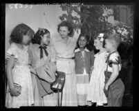 Joan Allin and her children greet their Hopi guests for vacation