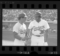 Dodgers Maury Wills and Frank Robinson talking during game in 1972