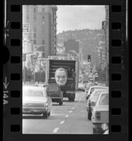 Truck carrying bust of Bob Hope driving down Hollywood Blvd., Hollywood (Los Angeles) 1972