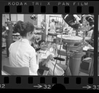 Gerardo Diaz de Leon being treated by student dental hygienist Bonnie McCampbell at USC Dental Clinic, 1972