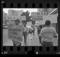 African Americans with placards, picketing Small Business Administration offices in Los Angeles, Calif., 1972