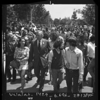 Politician Eugene J. McCarthy leading San Fernando Valley State College students on anti-war march in Northridge, Calif., 1972