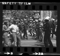 Police officers confronting anti-war demonstrators on UCLA campus, 1972