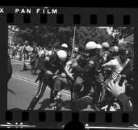 Police subduing protester during anti-war demonstration at UCLA, 1972