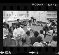 Congresswoman, Shirley Chisholm playing with children at South Central Community Child Care Center, Los Angeles, Calif., 1972