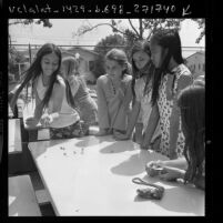 Luisa Ranieri and others competing in jacks game tournament at Atwater Elementary School in Los Angeles, Calif., 1972