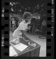 "NBC's Studio 9 janitress, Anita Taylor dusting during filming of ""Days of Our Lives"" in Burbank, Calif., 1972"
