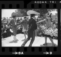 Dancers on Olvera Street performing for minibus crowd in Los Angeles, 1972