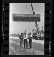 """Engineers testing electronic """"Freeway Condition"""" alert sign in Los Angeles, Calif., 1972"""