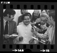 Shri Sant Ji Maharaj (Prem Rawat) surrounded by reporters upon arrival in Los Angeles, Calif., 1972